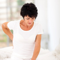 Woman In Back Pain